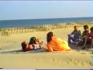 two couples for voyeurs on the beach